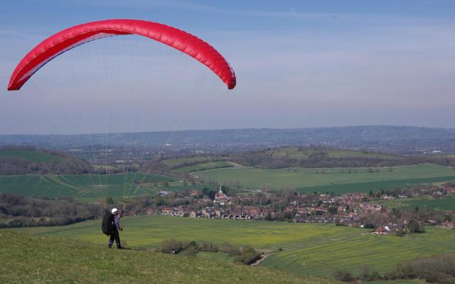 Parasailor launching off Harting Down, South Harting, West Sussex