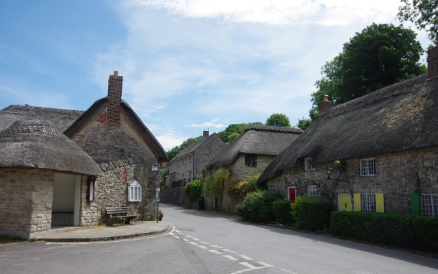 Thatched homes and thatched bus shelter, West Lulworth, Dorset